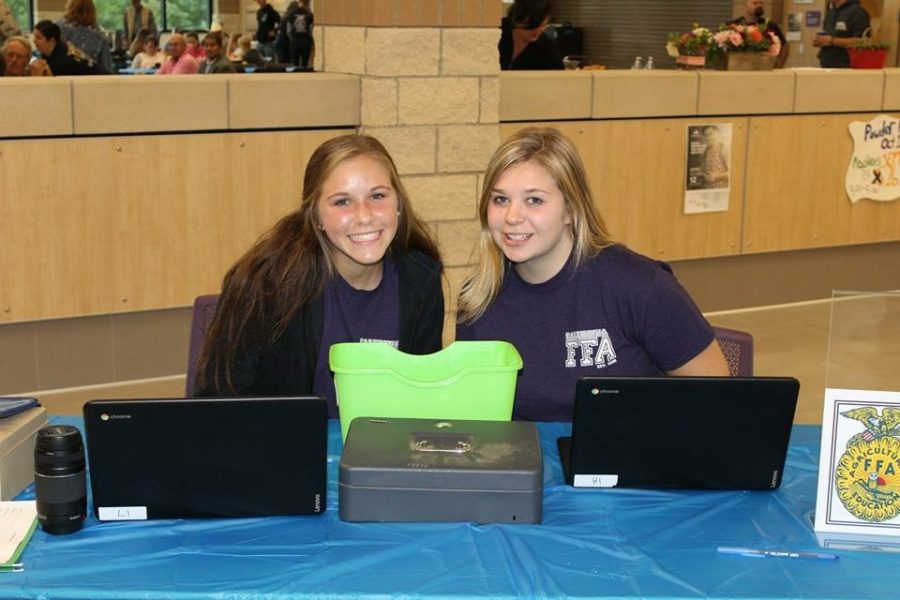 Zoey Zupin and Annalise Runkel pose together at the FFA hog roast. The FFA hog roast is an event put togehter by students