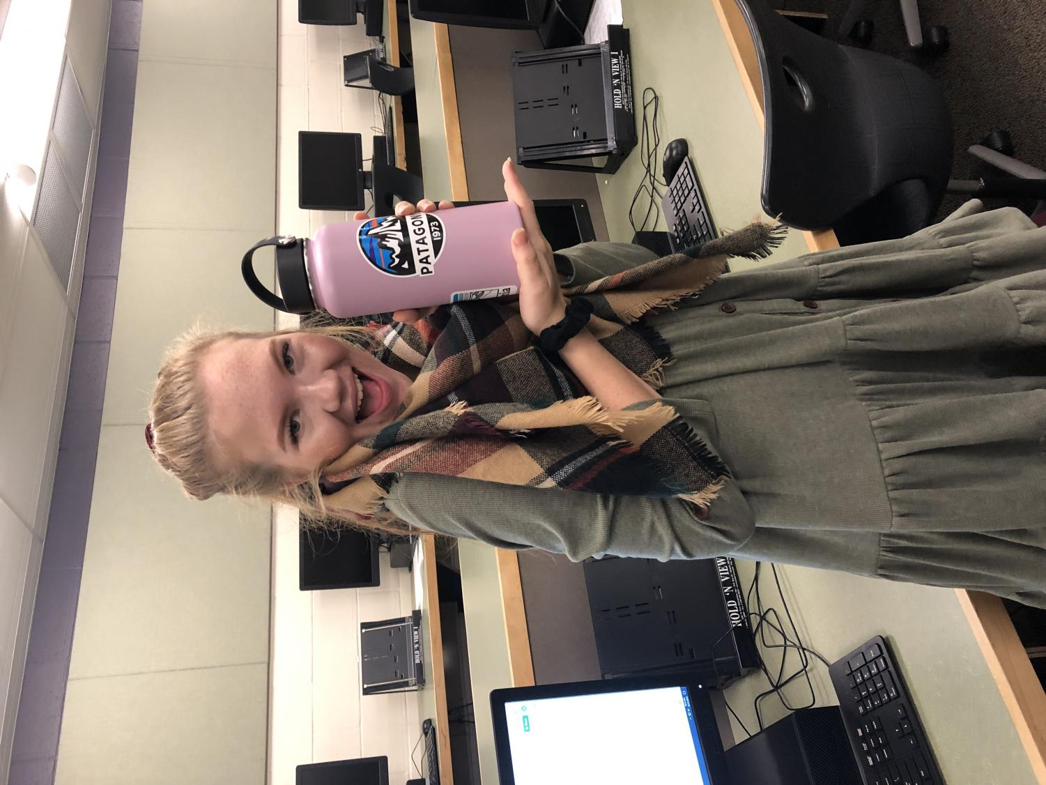 Maggie George poses with her Hydroflask and scrunchie.