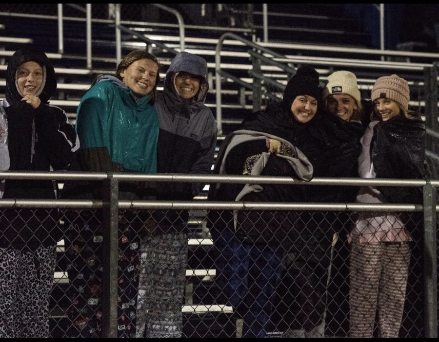 Abby Stegehuis, Abby Mitchell, Taylor Visscher, Hannah Smith, Lindsey Peters, and Maggie Seekell bundle up to face the brutal winds on Friday night's game.