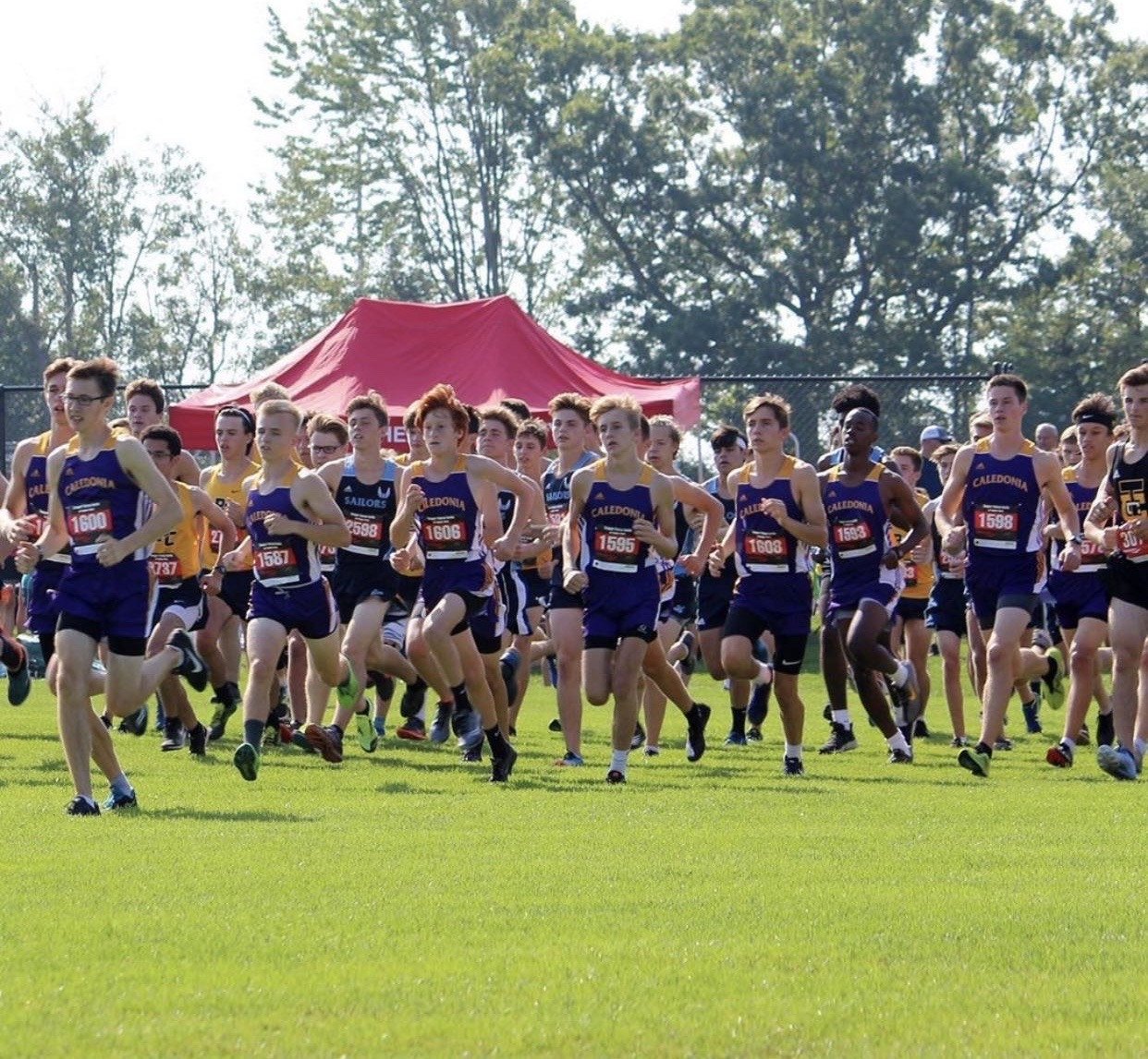 Boys Cross Country team compete at a meet.
