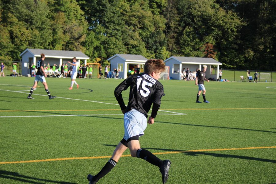 Senior Timothy Knoertzer keeps his eyes on the ball as he defends the goal.