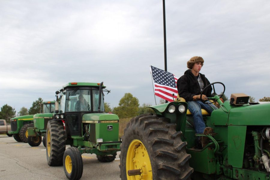 FFA students drive their tractors home after school.