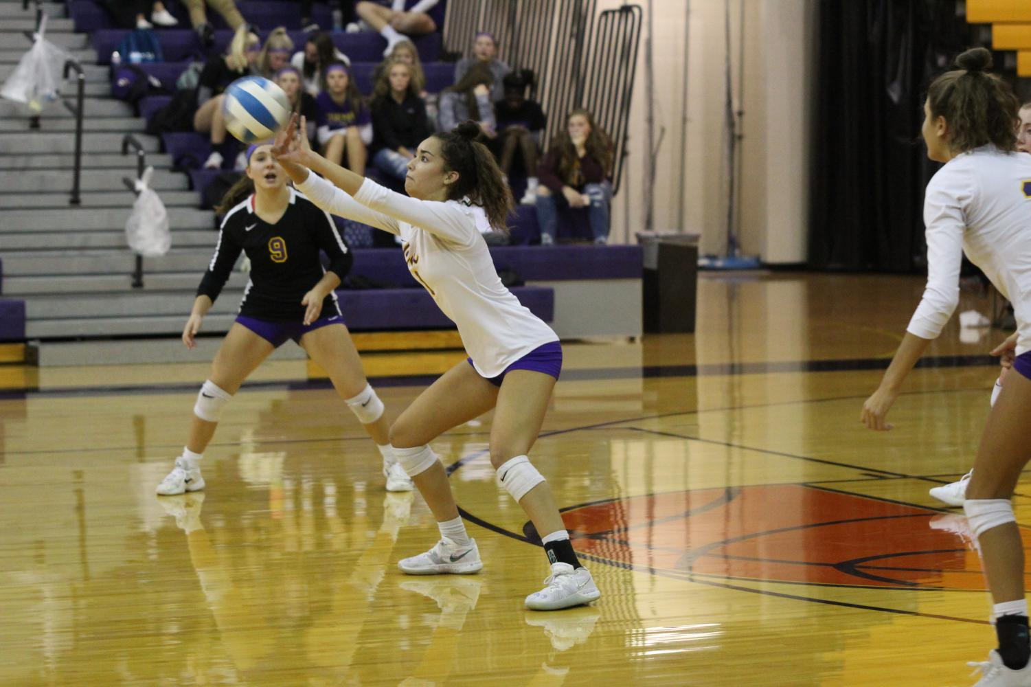Outside hitter, Audrey Torres, setting the ball.