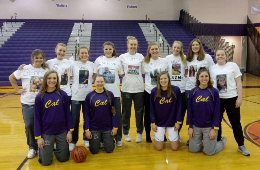 Madison+and+fellow+seniors+pose+with+underclassman+teammates+wearing+personalized+t-shirts+of+young+photos.
