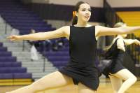 Pictured is Kamden Mullder performing a routine at the orange out basketball game.