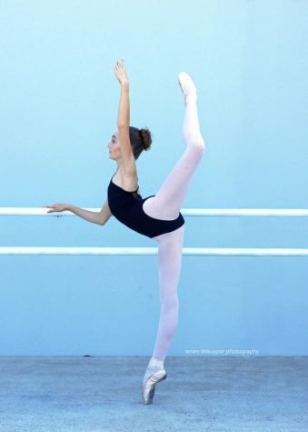 A dancer shows off her technique while at the barre.