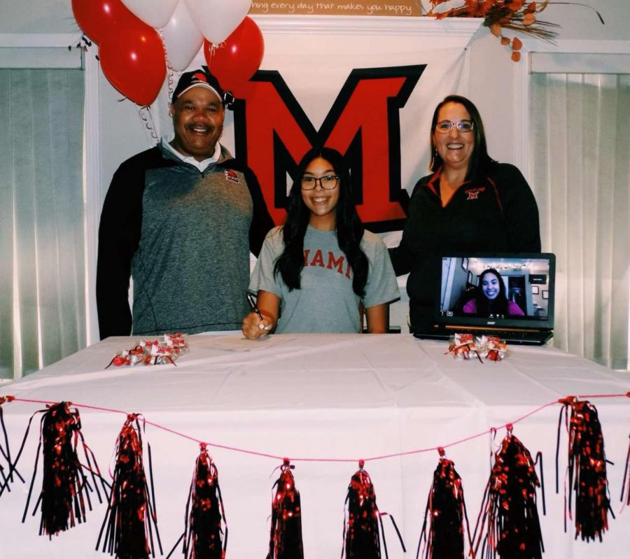 This photo captures Harper on her signing day, she signs over to Miami University, to continue her volleyball career and play at the collegiate level.