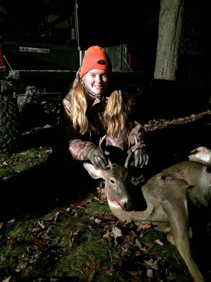 Paige pictured with her first ever buck!