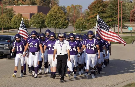 Head coach Tom Burrill leads his Fighting Scots to the football field in hopes of a Friday night win.