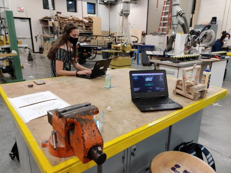 During first macro in Mr. Scholten's class, Katie Meeuwenberg is working on her catapult project report for Applied Mechanics. This picture was taken before the school building shut down.