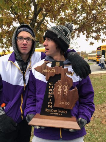 After the Caledonia boys cross country team won regionals, Jordan Domnay and Caden Dixon held the regional championship plaque.