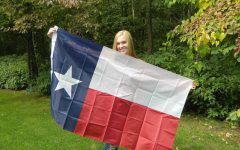 Audrey proudly poses with her beloved Texas flag.
