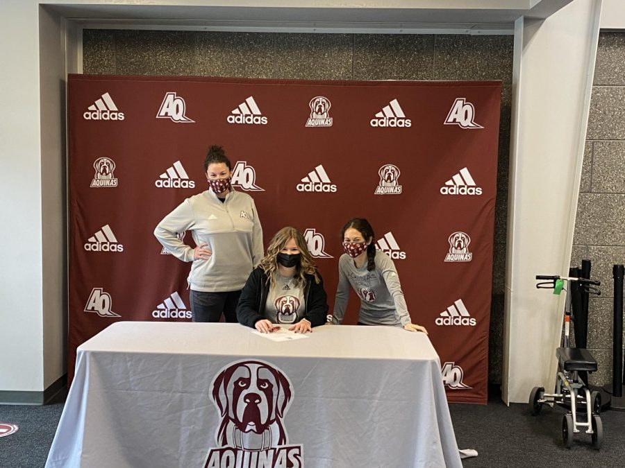 Sophia Schmader was able to do her signing at Aquinas College where she plans to attend in the fall.