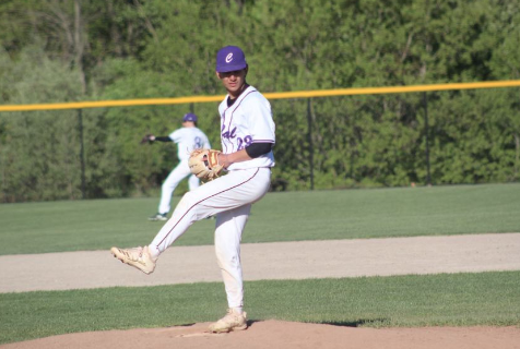 Nikolas Clark winds up to pitch a fastball against Thornapple Kellogg in the 7th inning.