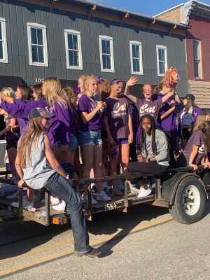 Girls cross country team enjoys interacting with the community at the homecoming parade.